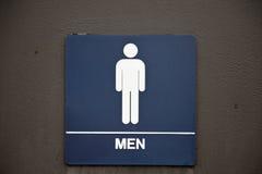 Muestra del cuarto de baño de los hombres Fotos de archivo