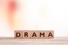 Muestra del drama en una tabla fotos de archivo