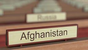 Muestra del nombre de Afganistán entre placas de los países diferentes en la organización internacional libre illustration