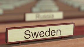 Muestra del nombre de Suecia entre placas de los países diferentes en la organización internacional libre illustration