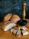Muestra del pan amargo con Olive Oil y pimienta Foto de archivo libre de regalías
