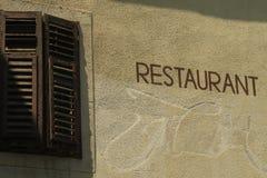 Muestra del restaurante en la pared Imágenes de archivo libres de regalías