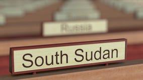 Muestra del sur del nombre de Sudán entre placas de los países diferentes en la organización internacional ilustración del vector