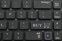 Muestra del teclado y de la compra Foto de archivo