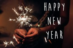 Muestra del texto de la Feliz Año Nuevo, tarjeta de felicitación Feliz Año Nuevo y feliz Imagen de archivo