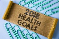 Muestra del texto que muestra la salud 2018 Golas Metas sanas de la resolución de la comida de la foto del Año Nuevo del entrenam Imagenes de archivo
