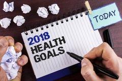 Muestra del texto que muestra la salud 2018 Golas Metas sanas de la resolución de la comida de la foto del Año Nuevo del entrenam Fotografía de archivo