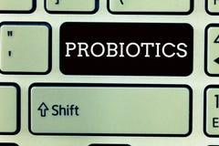Muestra del texto que muestra Probiotics El microorganismo vivo de las bacterias de la foto conceptual recibió en el cuerpo para  foto de archivo