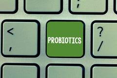 Muestra del texto que muestra Probiotics El microorganismo vivo de las bacterias de la foto conceptual recibió en el cuerpo para  imagen de archivo