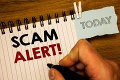 Muestra del texto que muestra a Scam llamada de motivación alerta Advertencia conceptual de la seguridad de las fotos para evitar Foto de archivo libre de regalías