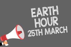 Muestra del texto que muestra tierra hora el 25 de marzo El compromiso conceptual del símbolo de la foto con el planeta organizó  stock de ilustración