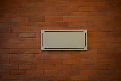 Muestra en la pared de ladrillo Fotografía de archivo libre de regalías
