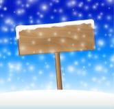 Muestra en prado de la nieve con nieve que cae Imágenes de archivo libres de regalías