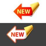 Muestra nueva bajo la forma de flecha. Vector. Fotografía de archivo