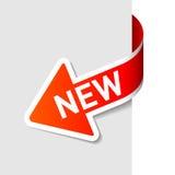 Muestra nueva en la flecha. Vector. Fotos de archivo