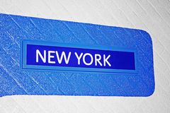 Muestra a Nueva York en una pared de ladrillo Fotos de archivo