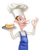 Muestra perfecta de Holding Hotdog Giving del cocinero Imagen de archivo libre de regalías