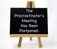 Muestra pospuesta reunión del ` s del Procrastinator Imagen de archivo libre de regalías