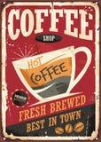 Muestra retra de la lata de la cafetería con la taza del coffe y el mensaje promocional Imagen de archivo