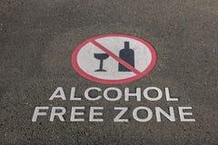 Muestra sin alcohol de la zona en el pavimento foto de archivo
