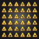 Muestras amarillas de la alerta y del peligro Foto de archivo