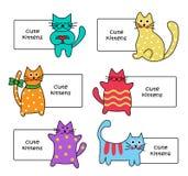 Muestras con los gatitos de la historieta Foto de archivo
