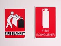 Muestras de la ubicación de la manta y del extintor del fuego Imagen de archivo