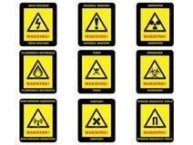 Muestras de peligro amonestadoras Imágenes de archivo libres de regalías