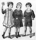 Muestras de ropa de moda de una revista del viejo estilo Imagen de archivo libre de regalías