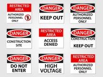 Muestras del peligro y del área restricta fijadas Imagen de archivo libre de regalías