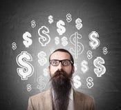 Muestras desconcertadas del hombre y de dólar en la pizarra Imagen de archivo
