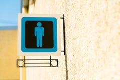 Muestras públicas del lavabo con un símbolo del caballero Fotografía de archivo