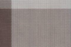 muestras tejidas plástico marrón de la tela, fondo de la textura imagen de archivo libre de regalías