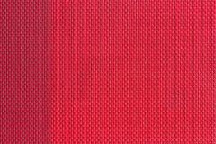muestras tejidas plástico rojo de la tela, fondo de la textura imagen de archivo