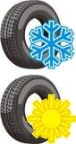 Muestras verano y neumático del invierno Foto de archivo libre de regalías