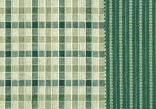 Muestras verdes y blancas de la materia textil. Fotografía de archivo