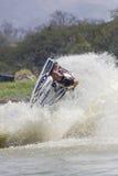 Muestre a estilo libre la acción del truco del esquí del jet Imágenes de archivo libres de regalías