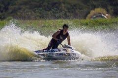 Muestre a estilo libre la acción del truco del esquí del jet Fotos de archivo