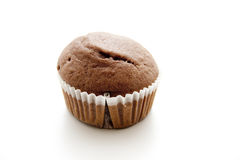 Muffin. Freshly baked brown muffin in paper cover Stock Photos