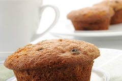 Muffin. Tasty homemade muffin placed on plate with coffee and abstract background Royalty Free Stock Images
