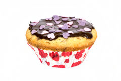 Muffin. Chocolate decants, hearts grace royalty free stock photo