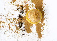 Muffin with apple, cloves and cinnamon. On white royalty free stock image
