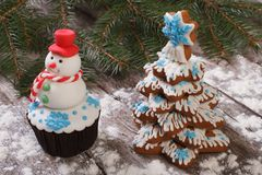 Muffin as a snowman and Christmas Tree Stock Image