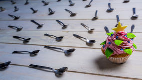 Muffin attacked by spoons Royalty Free Stock Images