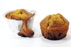 Muffin: bad vs good. Muffin: bad homemade vs good homemade muffin Royalty Free Stock Image