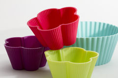 Muffin baking tins. Different colored baking tins for muffins, made out of silicone royalty free stock photo