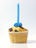 Muffin and blue candle. Cupcake with a birthday candle on Stock Photo