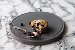 Muffin with blueberries. On a stand with a teaspoon Royalty Free Stock Photography
