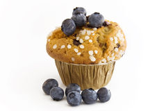 Muffin with blueberries on top. Delicious muffin with blueberries on top stock photo