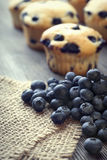 Muffin with blueberries on a wooden table. fresh berries and swe Royalty Free Stock Photo